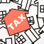 4 Factors to Lower Real Estate Taxes on Investment Property
